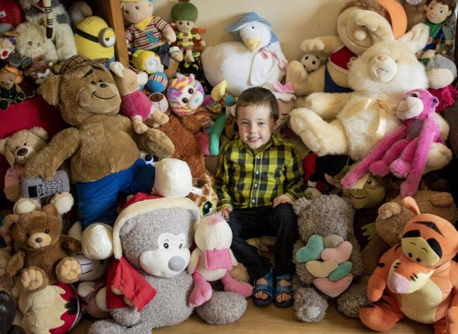 Lorcan McCafferry with some of the teddy bears he has collected.