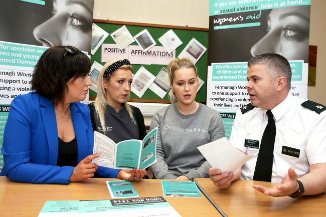 Michelle Alonso, (left), Training Co-Ordinator Fermanagh Women's Aid with Leanne Dolan, Ocean View Beauty Salon and Julie O'Shea, Eden Hair Dressing Enniskillen speaking with District Commander Clive Beatty.