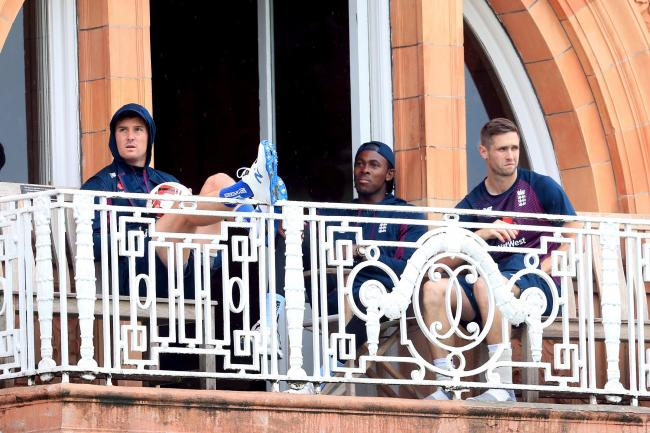 Jason Roy, Jofra Archer and Chris Woakes (left to right) look on as the first day of play is washed out