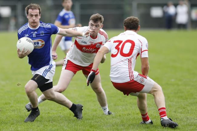 Ruairi Corrigan finds a gap in the Donagh defence.