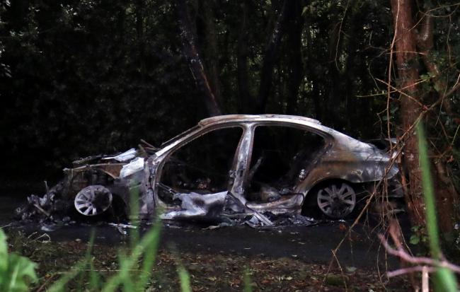 The remains of the burnt out car which was involved in the abduction of Quinn director, Kevin Lunney.