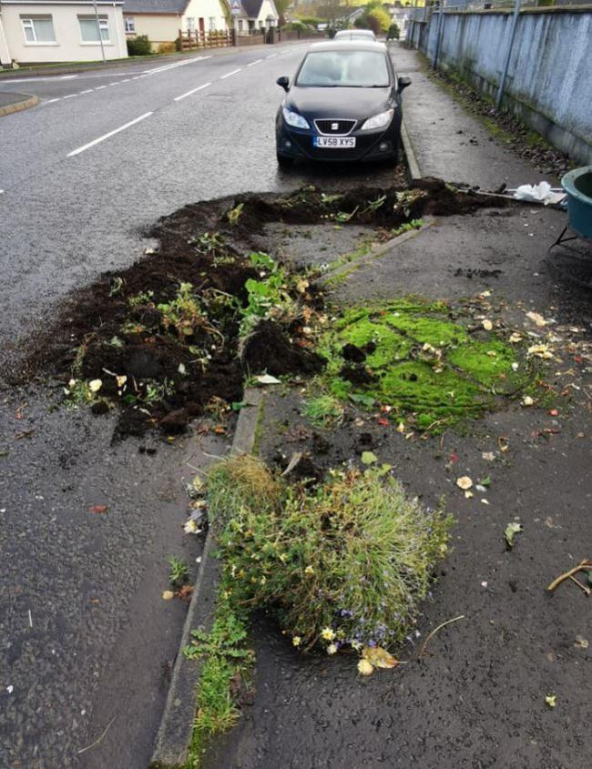 The flower pot which was knocked over and narrowly missed a car.