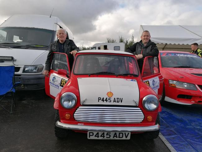 Thomas McGauran Senior and Thomas McGauran Junior in service prior to the start of the 2019 Lakeland Stages rally with the Mini the McGauran family, including son and brother Damien, built for the event.