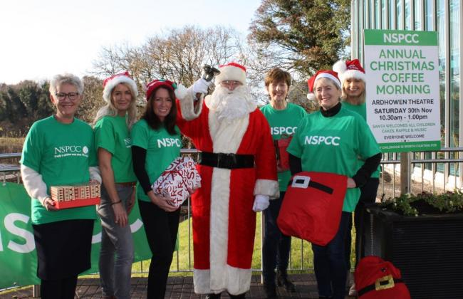Pictured with Santa are : Linda McDowell, Fiona Balfour, Una Welsh, Benny Sheridan, Helen McMurray and Diana Armstrong.