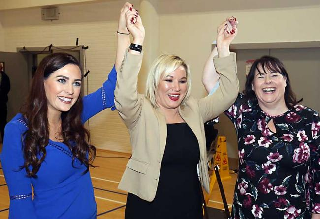 Deputy leader of Sinn Féin Michelle O'Neill (centre) with Órfhlaith Begley (left) and Michelle GIldernew (right) celebrating winning seats in West Tyrone and Fermanagh South Tyrone respectively.