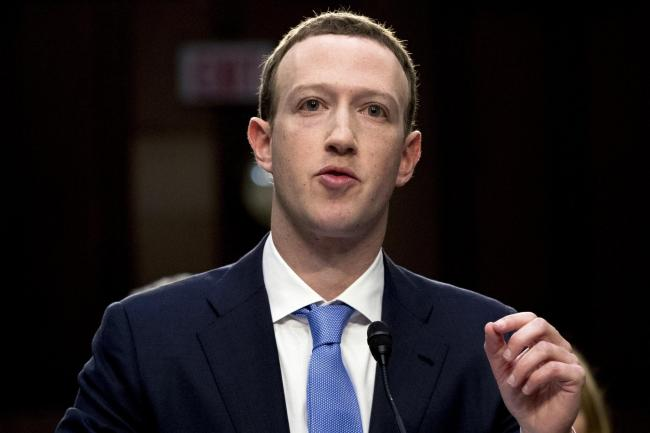 Facebook CEO Mark Zuckerberg testifies before a joint hearing of the Commerce and Judiciary Committees on Capitol Hill in Washington, Tuesday, April 10, 2018, about the use of Facebook data to target American voters in the 2016 election. (AP Photo/Andrew
