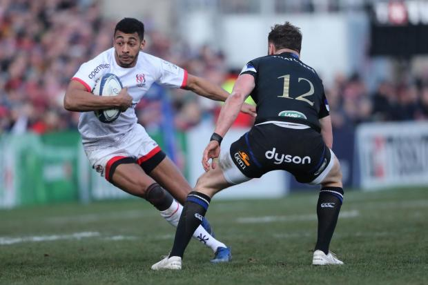 Ulster's Robert Baloucoune and Baths' Max Wright during the Champions Cup match last year. Photo: Niall Carson/PA Wire.