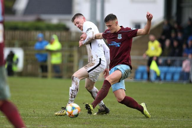 Ryan O'Reilly battles for possession against Ballymena at Ferney Park on Saturday.