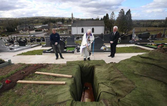Father Gerard Alwill saying a prayer during the burial of Fermanagh's first Covid-19 victim Anne Best, 72, at St. Ninnidh's cemetery in Derrylin on Saturday. Photos by John McVitty. All photographs were taken with permission from Mrs. Best's family.