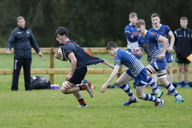 Callum Smyton on the way to scoring a try.