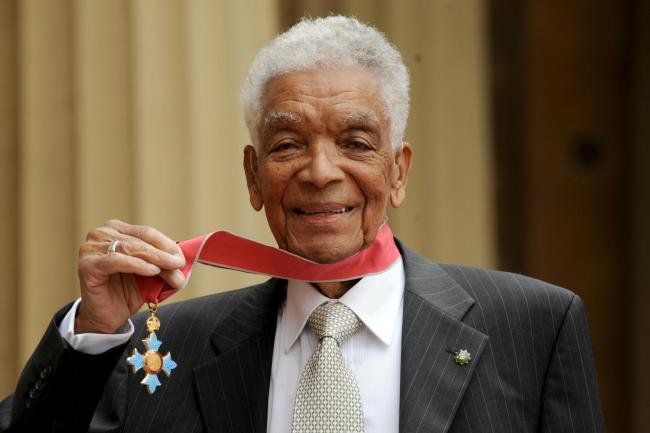 Actor Earl Cameron outside Buckingham Palace with his CBE