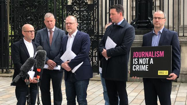 (left to right) Journalist Barry McCaffrey, solicitor Niall Murphy, journalist Trevor Birney, solicitor John Finucane and Amnesty International's Patrick Corrigan outside the Royal Courts of Justice in Belfast. Journalists Birney and McCaffrey have ca
