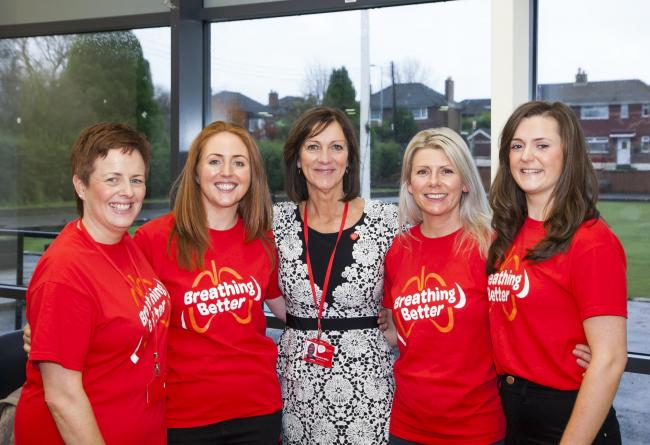Pauline Millar, head of respiratory services at NI Chest Heart & Stroke, pictured before social distancing measures were introduced, with Linzi Davidson (second from right), the charity's respiratory co-ordinator in the Western Trust area and ot