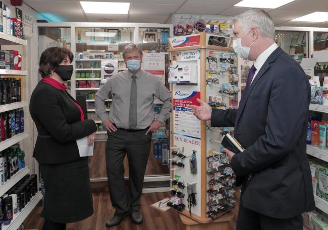 First Minister, Arlene Foster  meets with Paul Hughes of Hughes Pharmacy and Chief Executive of Community Pharmacy NI, Gerard Greene, to discuss the measures implemented by community pharmacies to ensure they remained open and supported their local commun