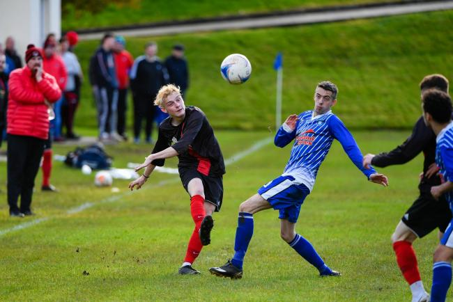 Fivemiletown work the ball up the wing.  Picture: Ronan McGrade