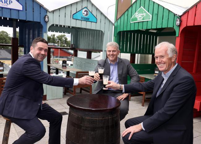 Secretary of State, Brandon Lewis, (centre), enjoying a drop of Guinness with Jonathan Styles, (right) and Michael Cadden, (left), Pats Bar Enniskillen when the bar was able to reopen last Summer.