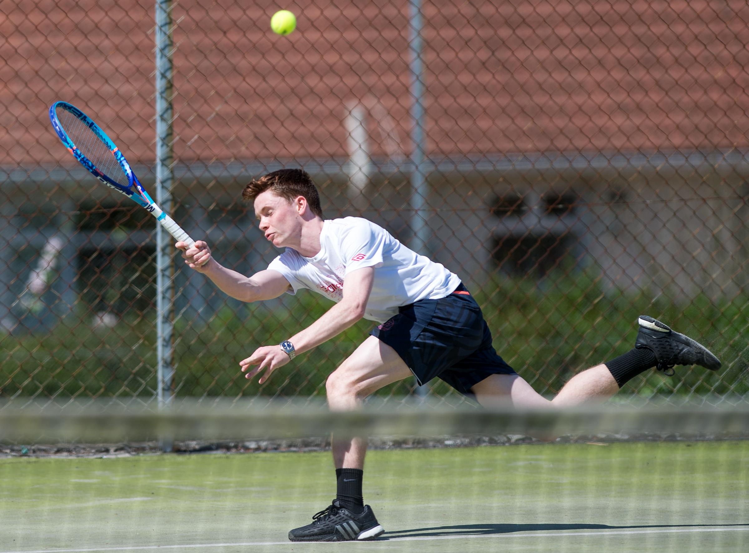 Ronan McKeever stretching for a shot during a rally in his Men's Singles final.*.