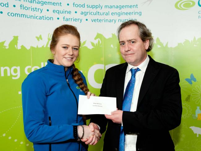 Megan McGrory, Lisnaskea, receiving the Coolmore Bursary from Paraic Dolan, Area Manager, Coolmore, Ireland.