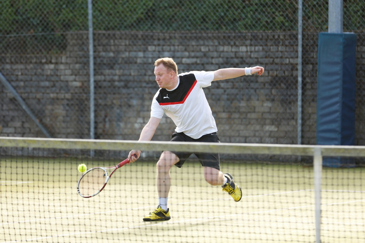 Clive Funston stretches to make a forehand.