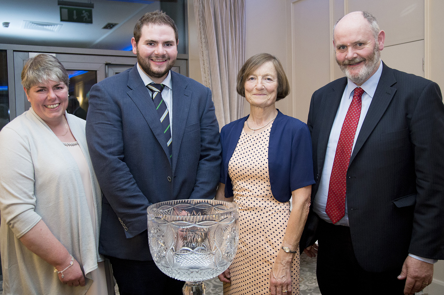 Adam Montgomery(second left) with his mother, Daisy(left) and father, David with Mrs. Ann Truesdale who made the award.