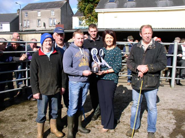 Ms Justine Howe, Manager of Danske Bank, Fivemiletown, sponsors of the suckled calves show and sale at Fivemiletown, presents the Perpetual Cup to the champion calf owner, Mr. W. Hoey. Pictured are other prizewinners.