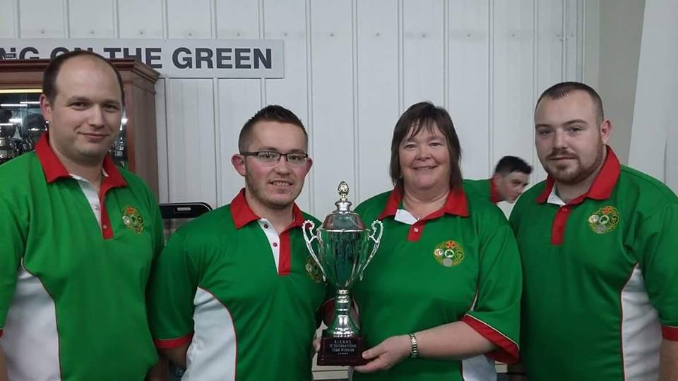 Local bowlers Ronnie Stubbs (left) and Esther Forster (second right) with their unbeaten Rink that helped Ireland to the title.