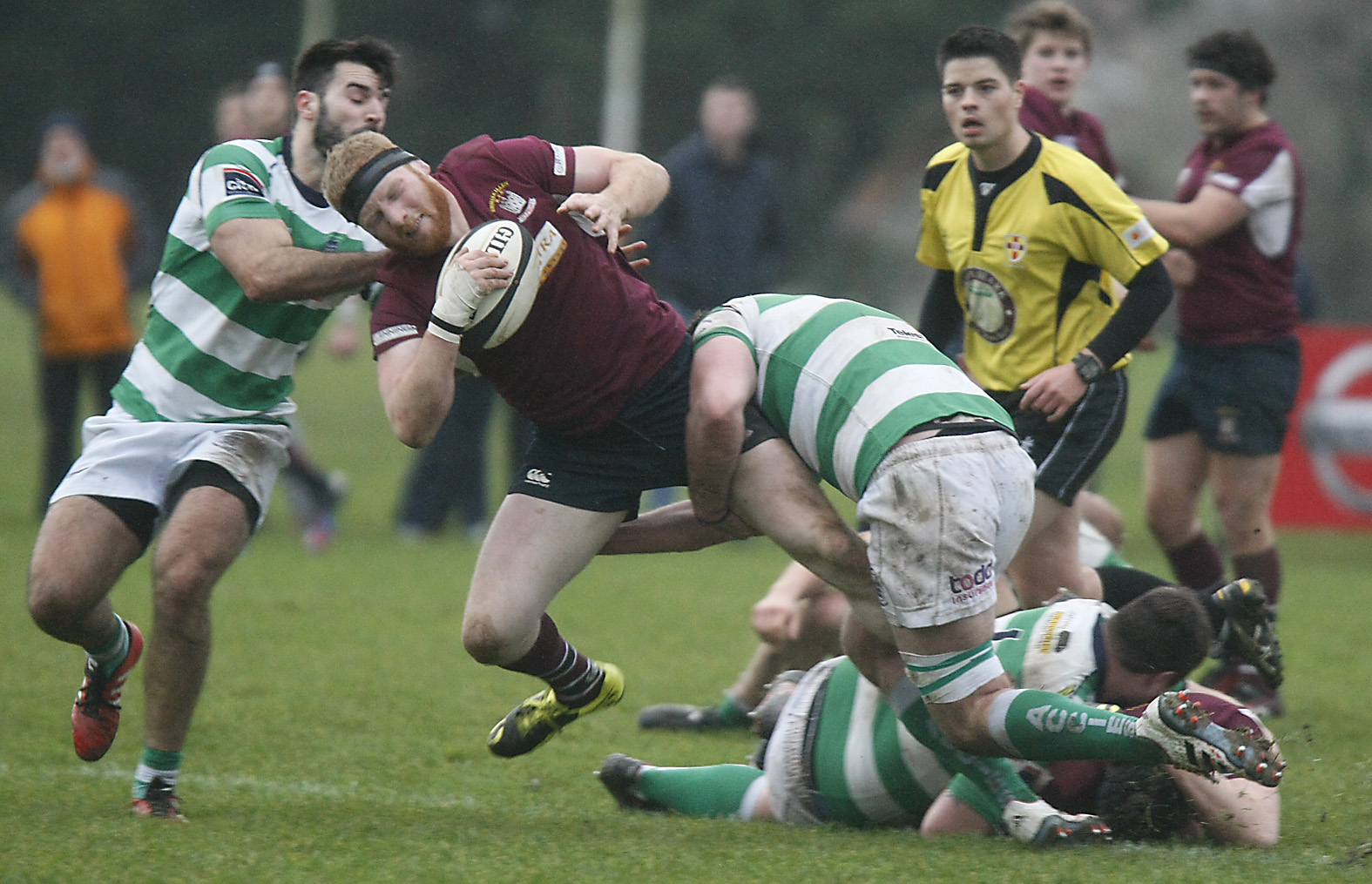 Skins' James Carleton is caught by Neil Brown and Johnny Sproule during the defeat to Omagh.