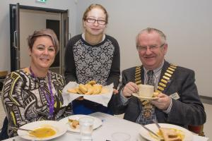 Rotary President Kenny Fisher sits down to lunch with Willowbridge Principal Julie Murphy during the club's recent visit to the school. Serving them biscuits is Alanna Woods.