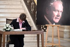 Arlene Foster signs a book of condolence at Stormont yesterday. Photo by PhotopressBelfast.co.uk.