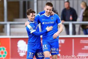 Goal scorers Ryan Mayse and Ryan Curran celebrate as the Mallards ran out 4-1 winners over Carrick Rangers at Ferney Park today.