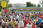 Marchers protest against climate policies on Trump's 100th day in office