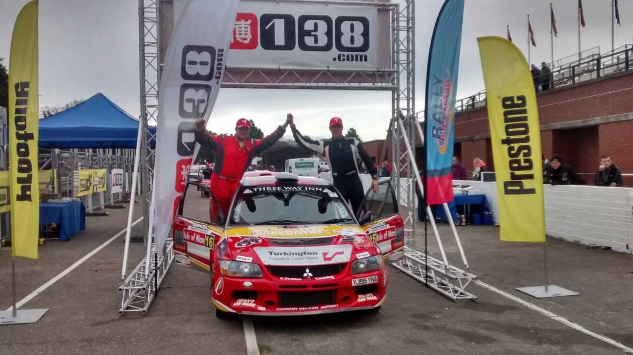 William Mavitty and Martin Connolly celebrate their Group N win at the Isle of Man Rally.