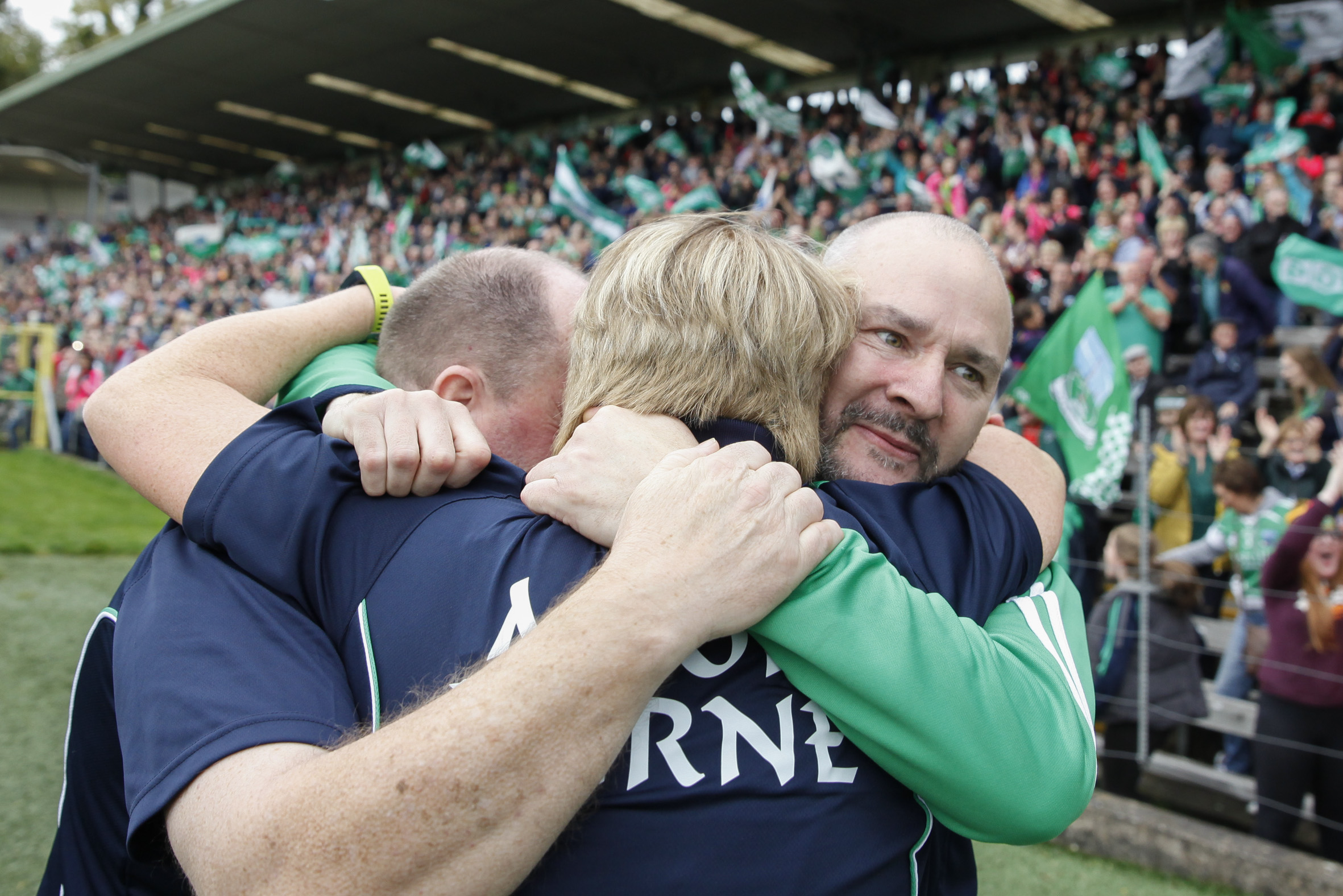The Fermanagh management team of Emmet Curry, Josie Boyle and Mickey Cadden embrace at the final whistle.