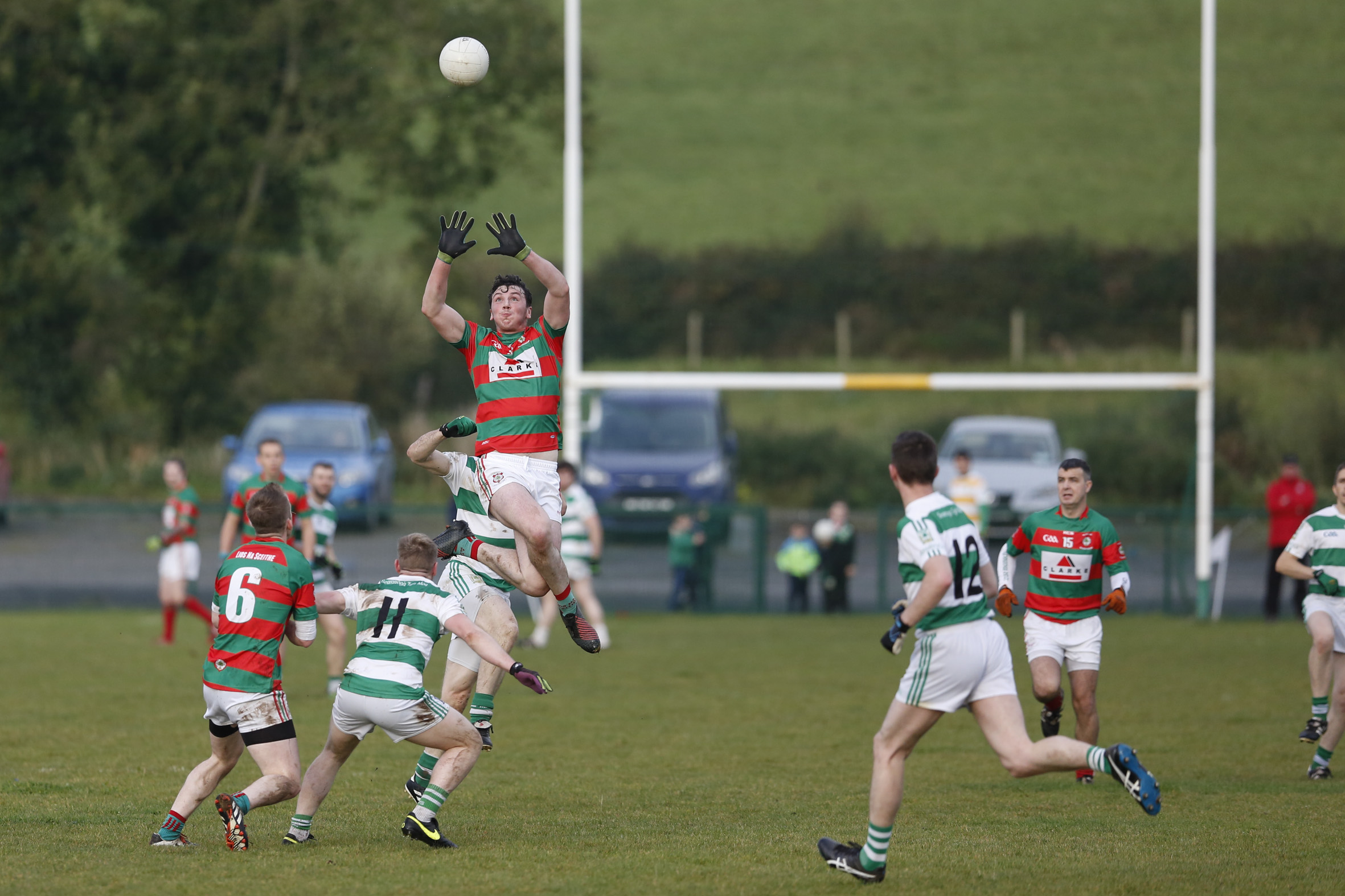 Lisnakea's Tomas Clarke takes to the air to win the ball at midfield during his side's win over Teemore.