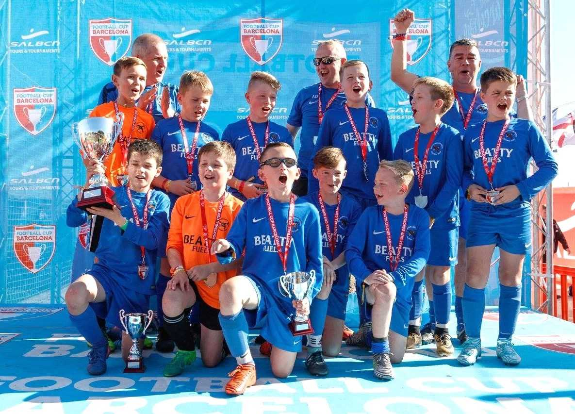 The victorious Ballinamallard U11 side and coaches who won the Barcelona Cup last weekend.