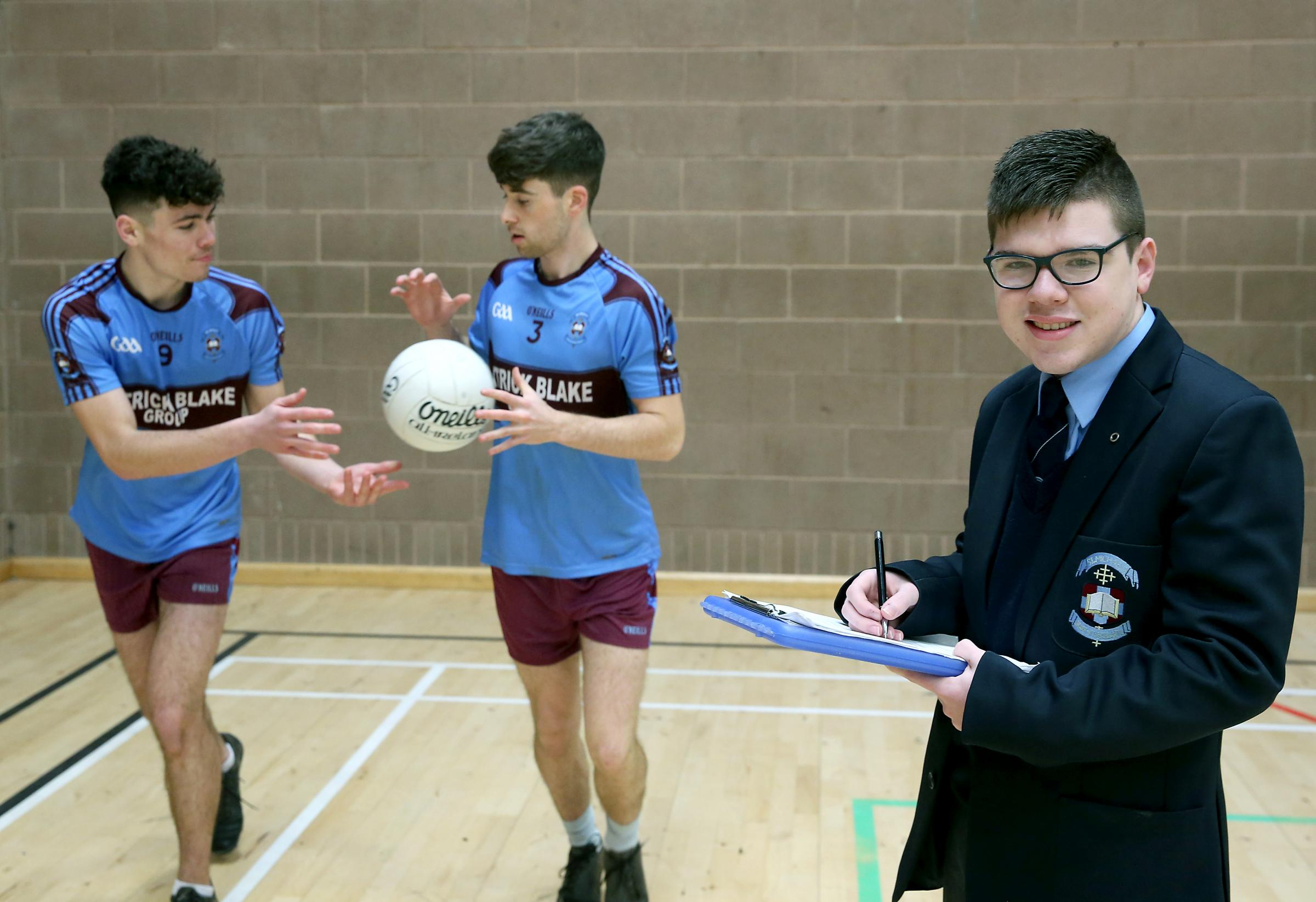 St. Michael's MacRory Cup stats person Mark McGoldrick is pictured with vice-captains Ryan Breen and Liam Owens.