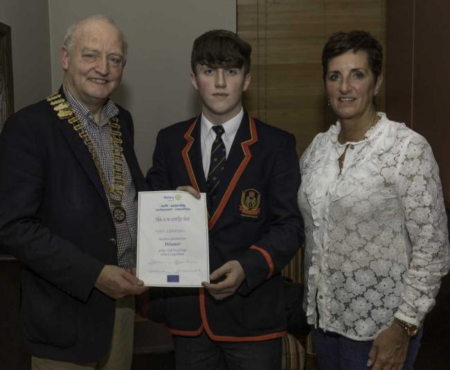 Local winner Mark Crawford pictured with Henry Robinson, President of the Rotary Club of Enniskillen, and Catherine Robinson, who chairs Enniskillen Rotary Club's Youth Services.