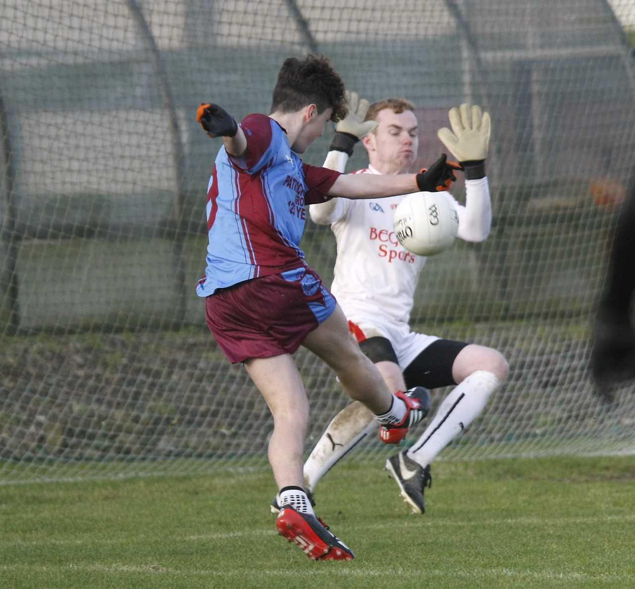 St Michael's forward Darragh McBrien slams the ball past the St Patrick's, Dungannon goalkeeper and was also on target in Wednesday's superb semi-final win over St. Pat's, Maghera.