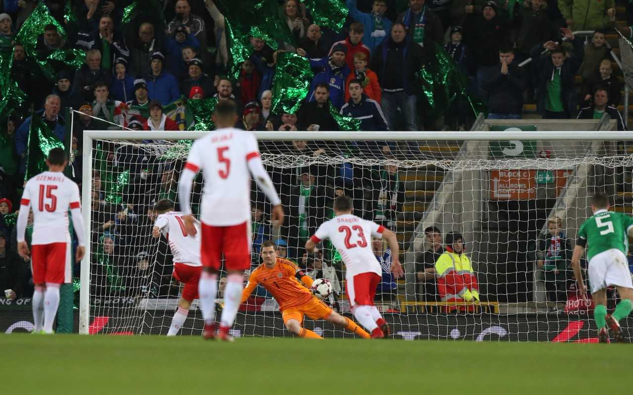 Michael McGovern has no chance with the controversial Switzerland penalty at Windsor Park. Photo: John McVitty