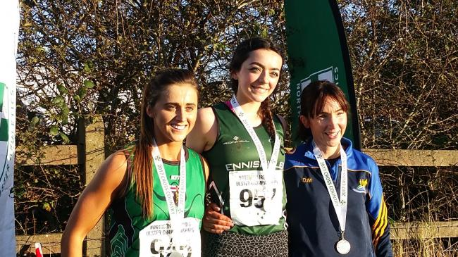 Edel Monaghan (centre) on the podium after winning gold.