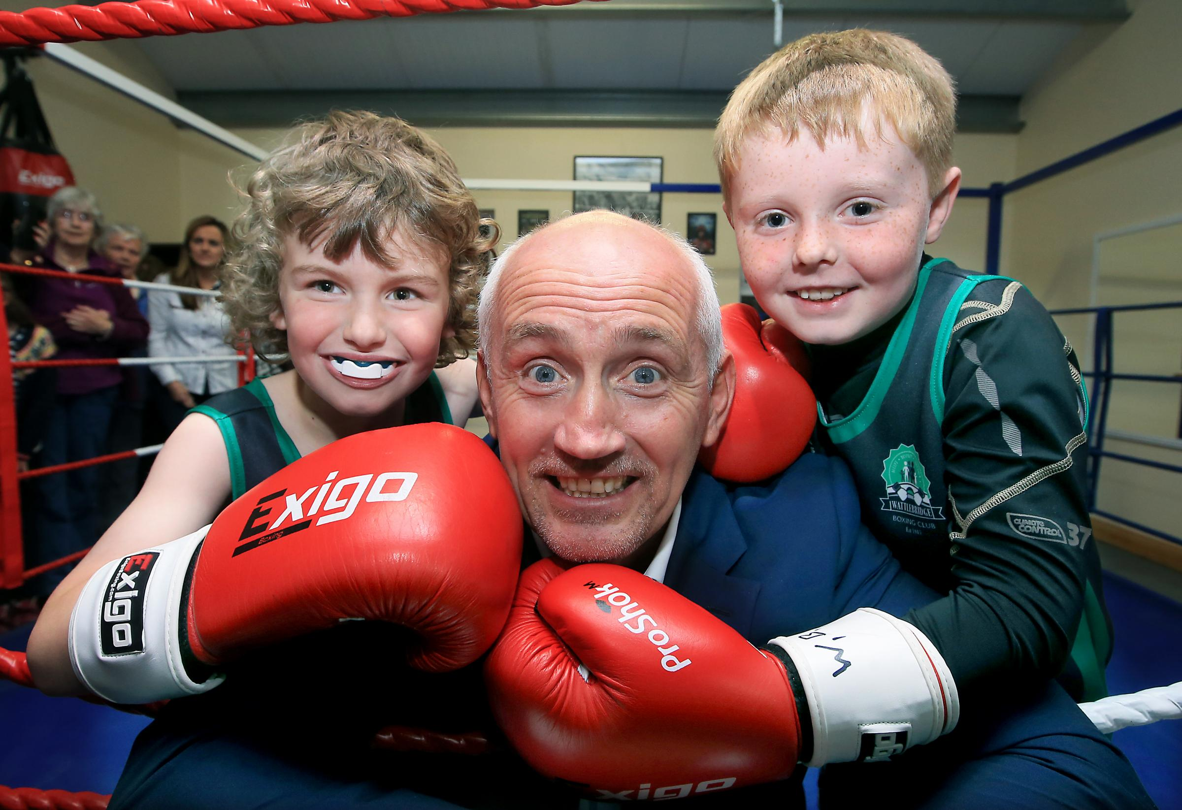 Barry McGuigan who will be the guest of honour at the Impartial  Reporter Celebration of Sport  is pictured with Luke  Sommerville and Seimi Manley  at the opening of Wattlebridge  ABC in 2015.