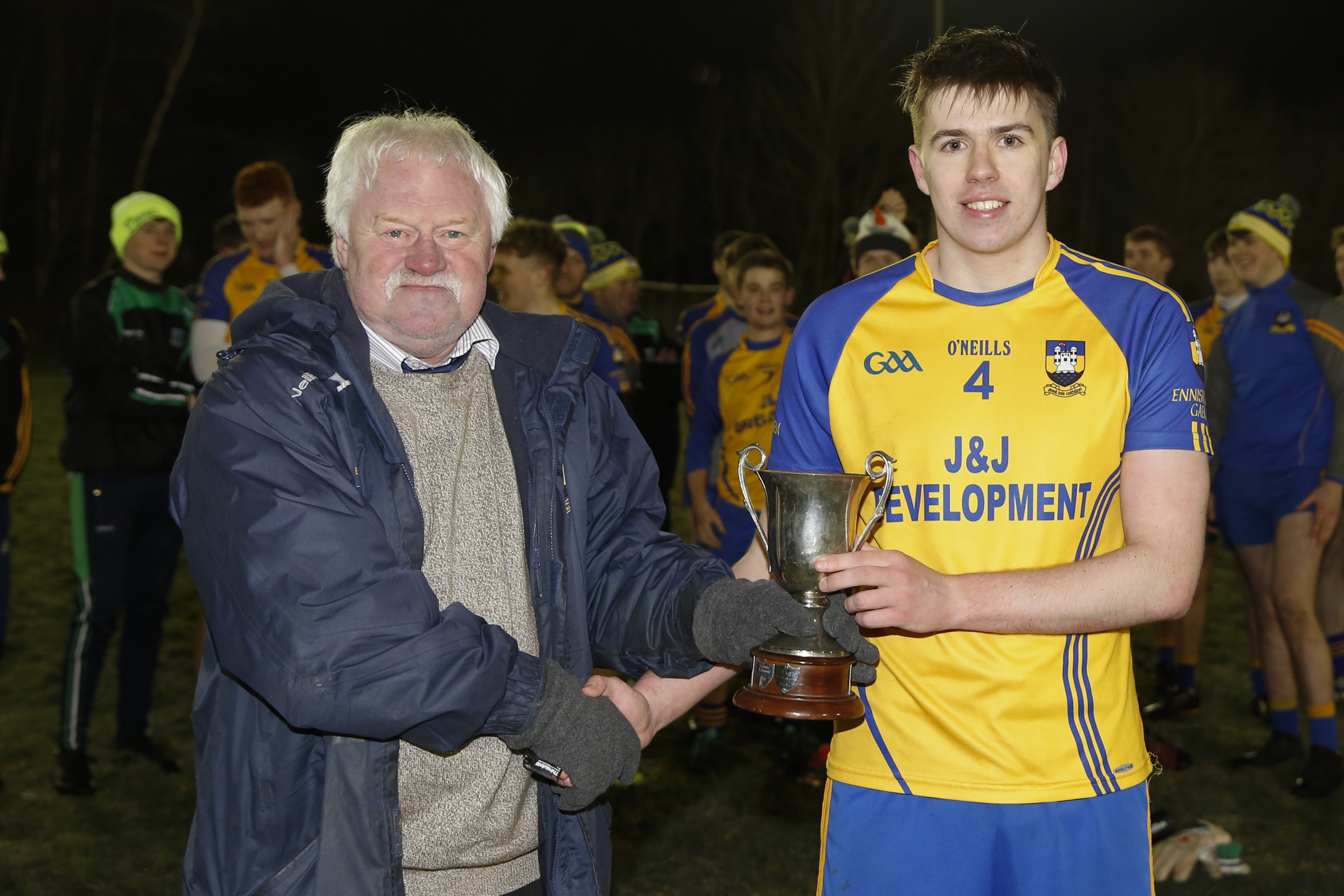Enniskillen Captain, Ciaran Smith accepts the U21 trophy from Fermanagh County Chairman, Greg Kelly.