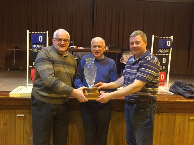 Harold Nixon and David Graham being presented with the Wesley Phair Pairs trophy by Jude Morris, representing the Phair family.
