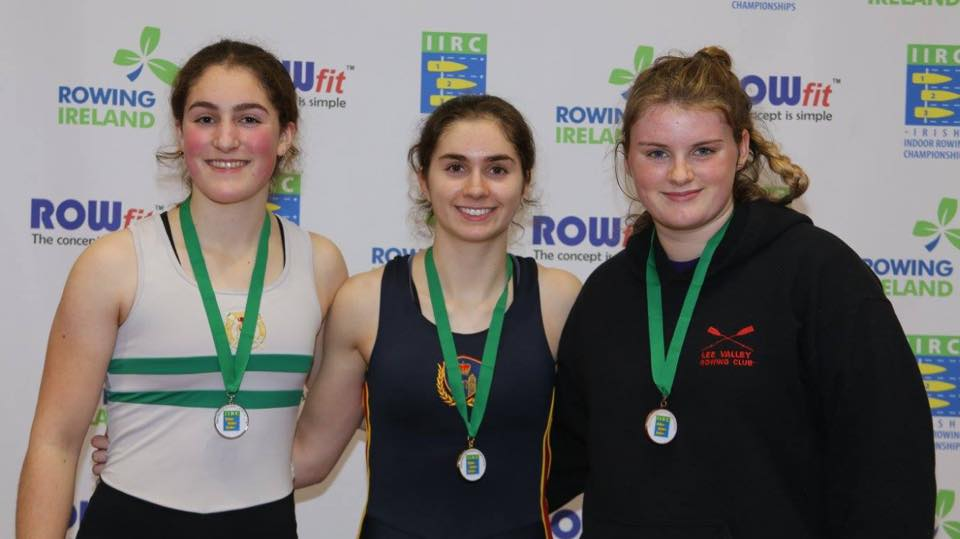 Gold medal winner in the WJ18, Zoe McCutcheon (centre) from Enniskillen Royal BC.