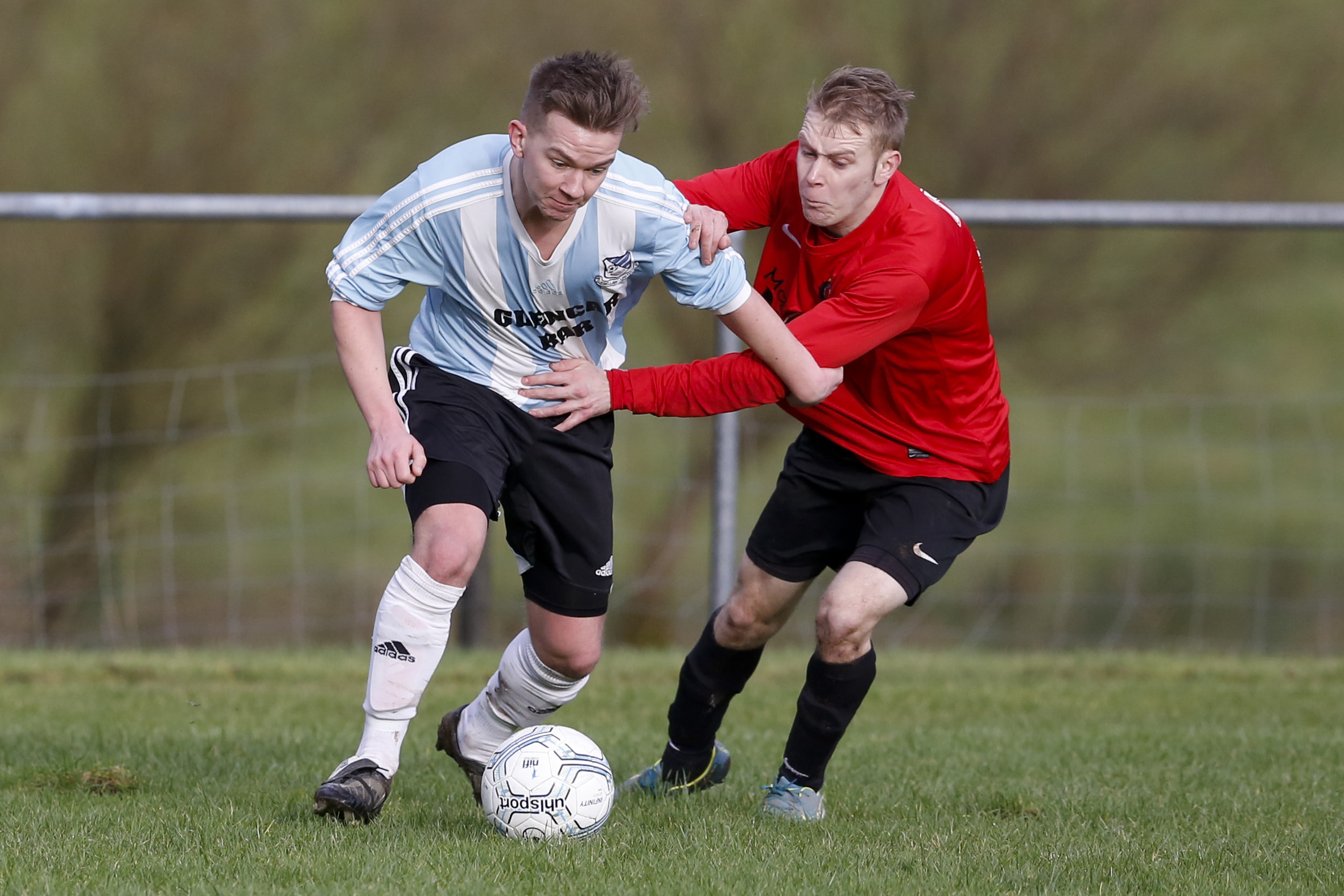 Lisbellaw's Andy Little and Joey Millar of Irvinestown vie for possession at Drumad on Saturday.