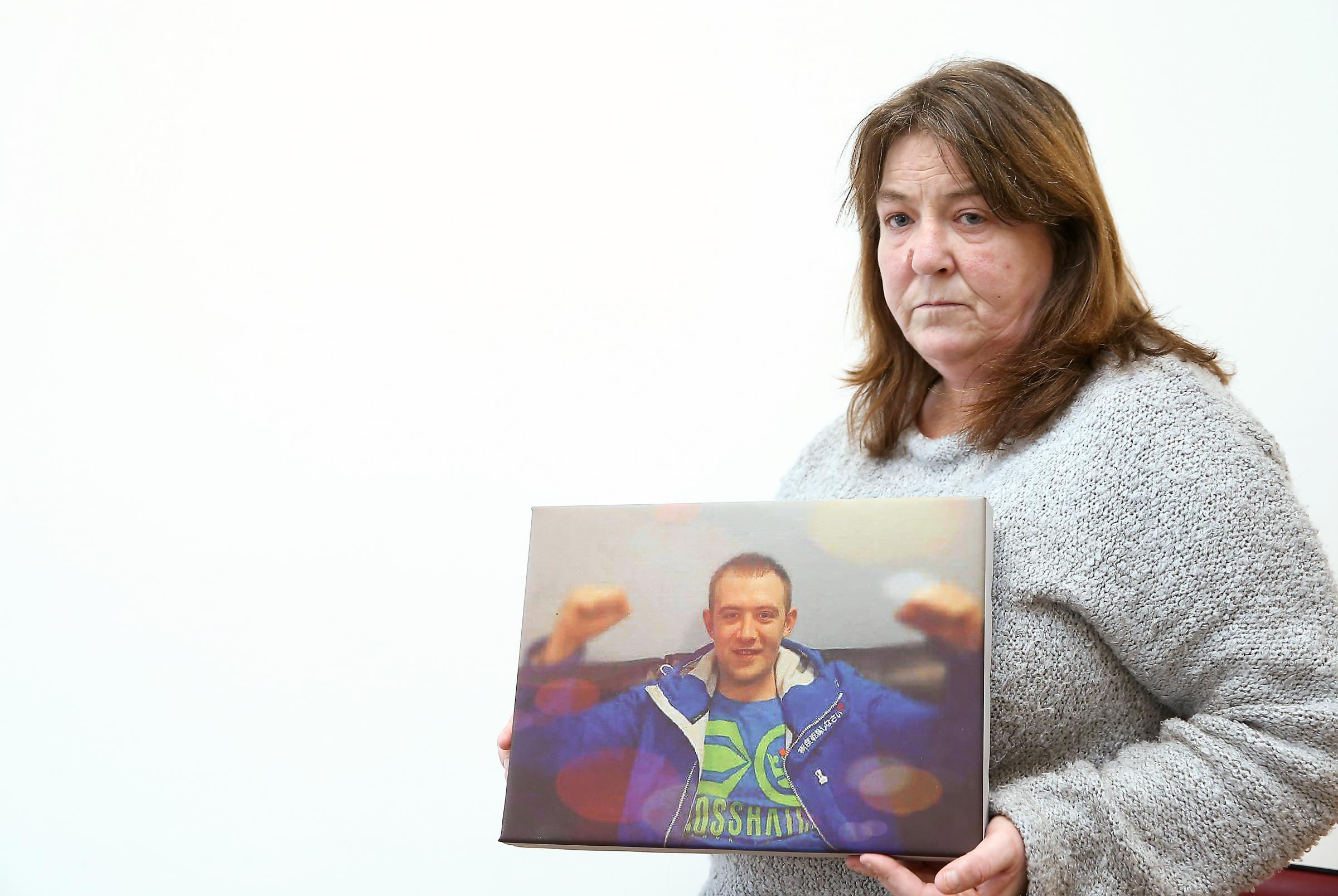 Mandy Masterson with a picture of her late son Christopher.