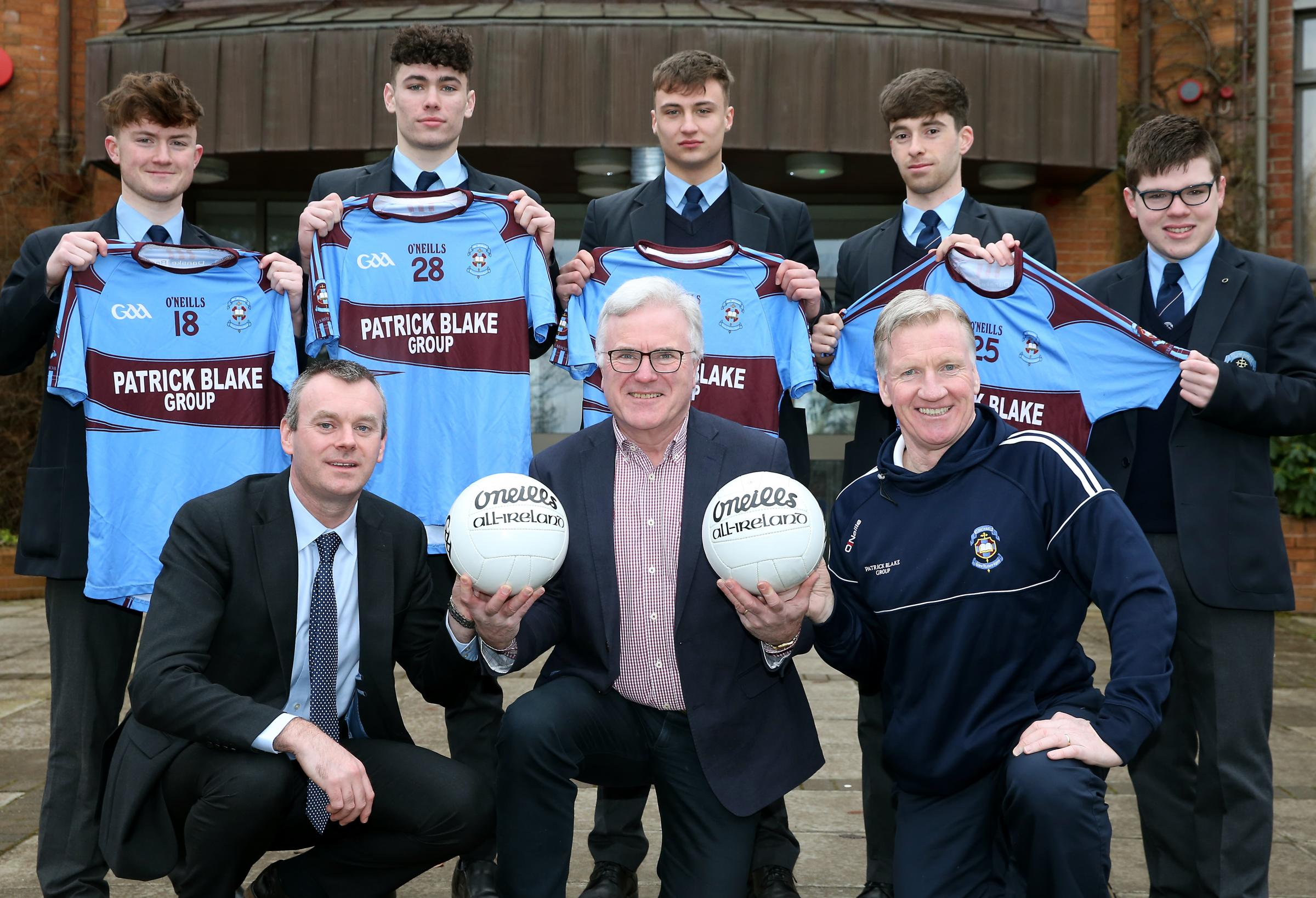 Pat Blake, (front centre), Patrick Blake Group sponsor St.Michael's MacRory Cup squad. Also included are front from left, Mark Henry, principal and Dom Corrigan, manager. Back from left, Fearghal McGovern, Ryan Breen, Paul McKervey, Liam Owens and Mark