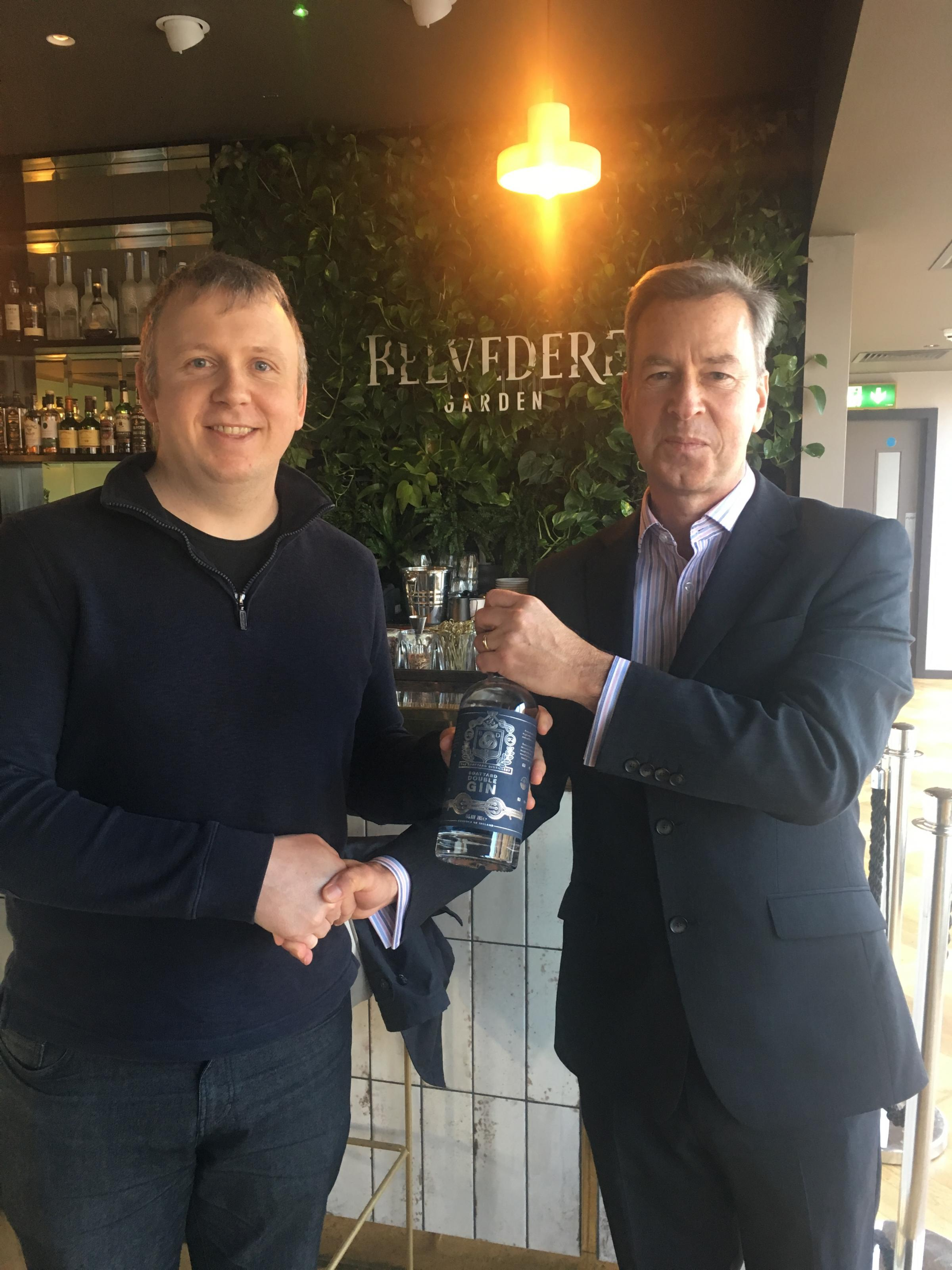 Pictured from left-right are: Joe McGirr, Founder of the Boatyard Distillery and Iain Lees, Managing Director of HannawayCA Corporate Finance.