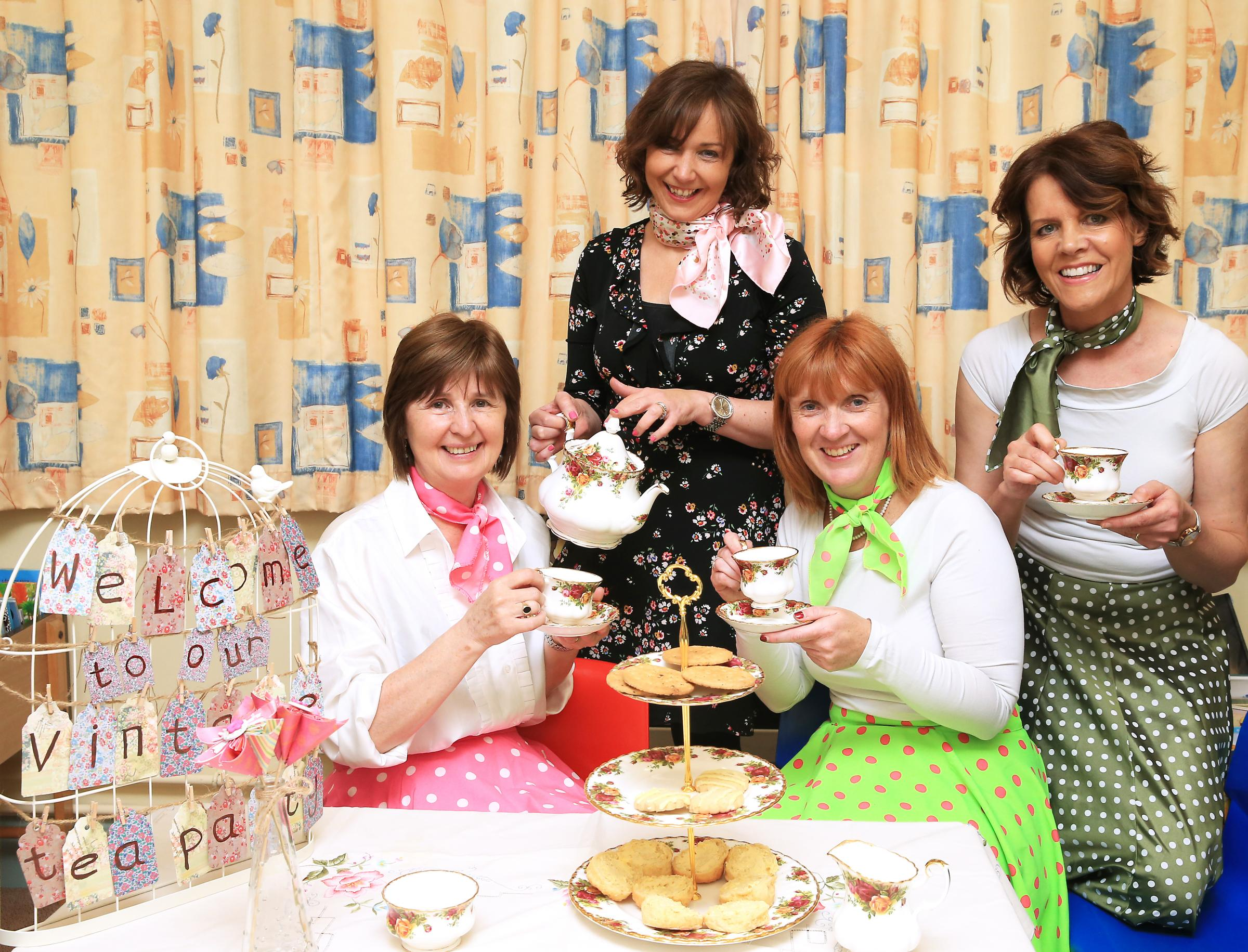 Staff at Maguiresbridge Primary School Edna McWilliams, Honor Irvine, Principal; Willene Hadden and Henrietta Fawcett getting ready for their Vintage Tea Party on Saturday, May 12 to raise money for Cancer Research UK and The North West Cancer Centre.