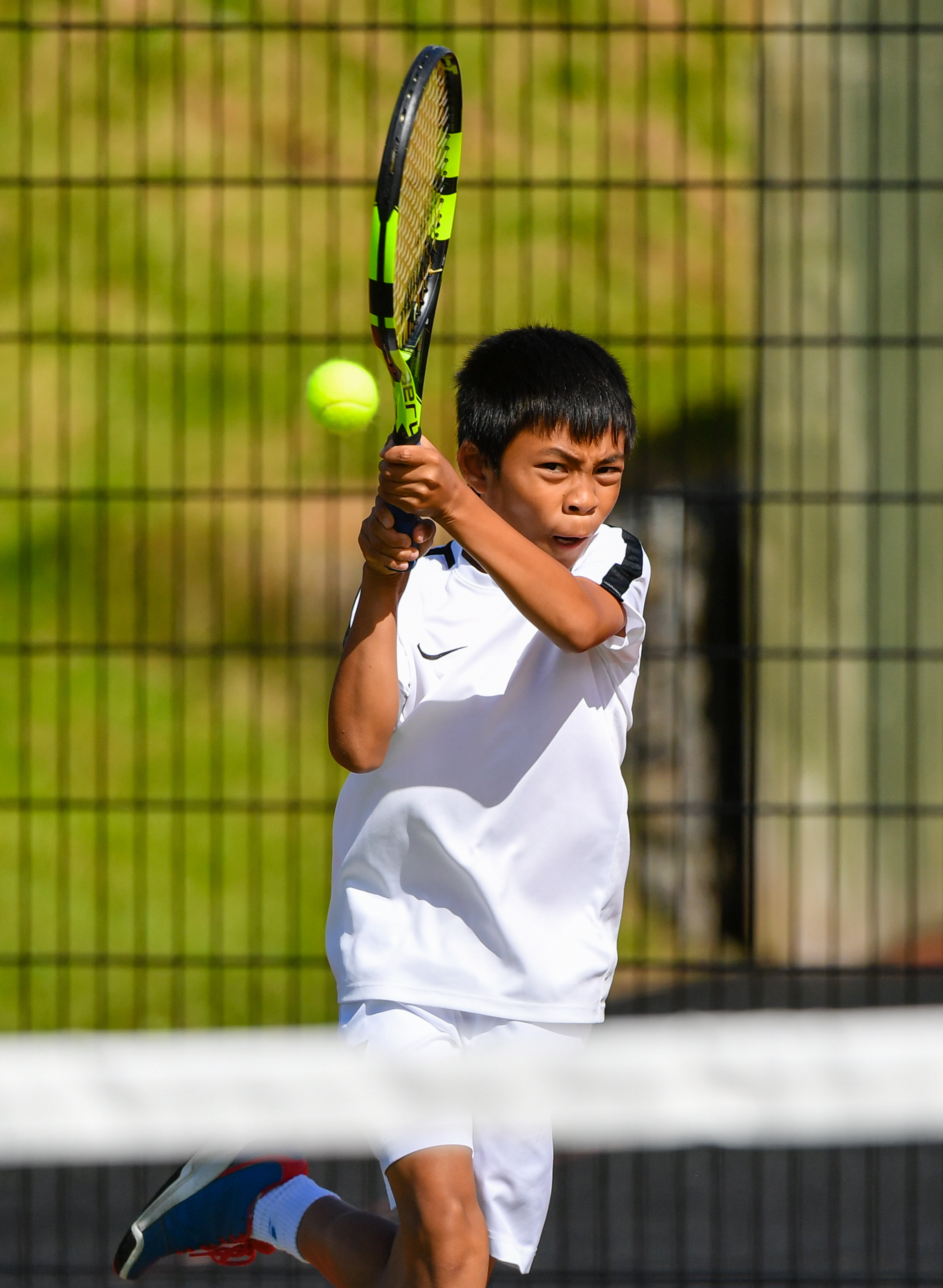 Ace Milan Rodriguez in the under 12 boys final.